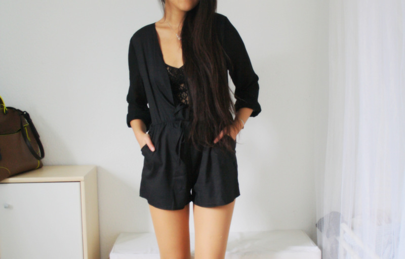 Black playsuit, lace and leather.